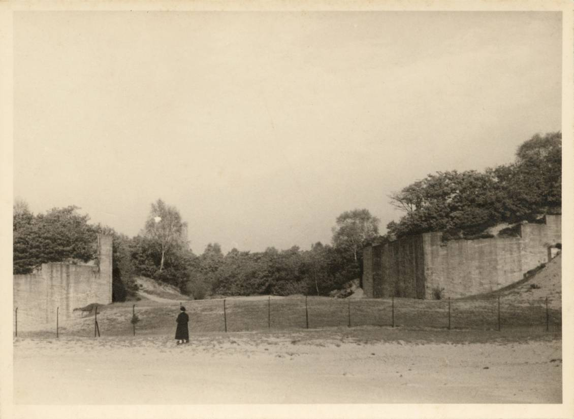 Helene Kröller-Müller looks over the foundations of the 'Grand Museum' after construction is halted in 1922