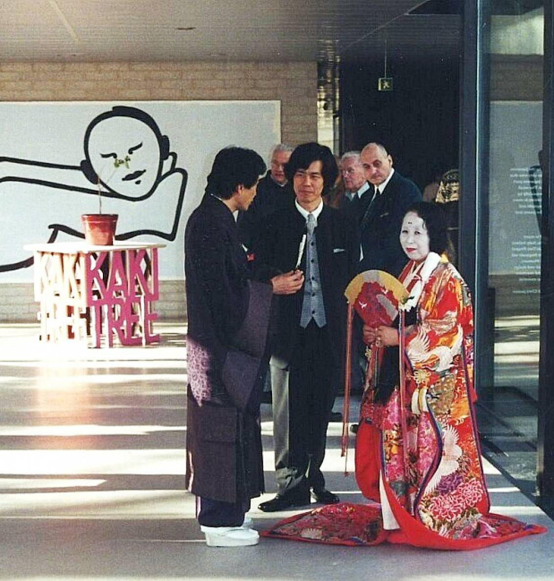 Hiroyuki Nakazawa and assistant during the opening of 'IKIRO/Be alive', 2001